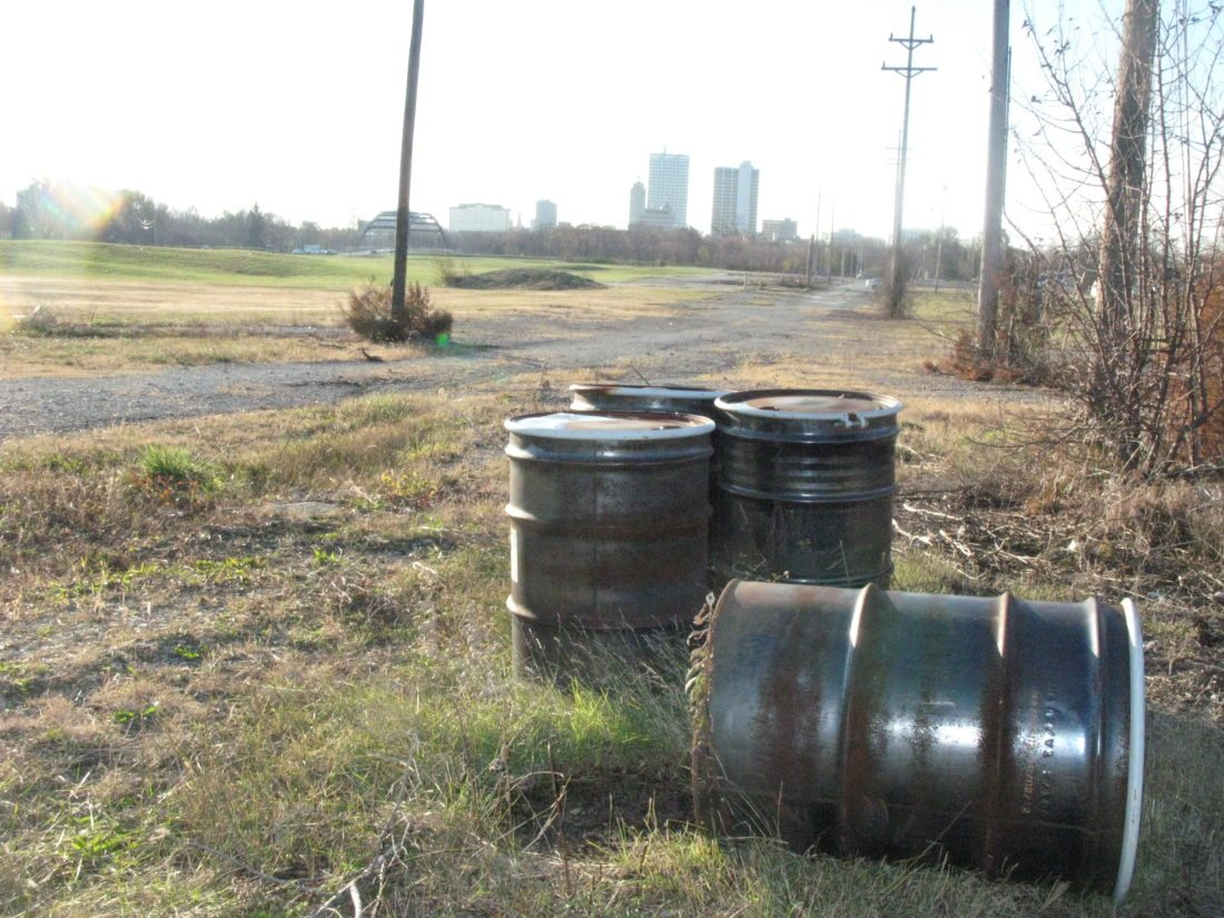 """These leftover barrels at the former OmniSource scrap yard site are labeled """"non-hazardous,"""" but it's what's buried there that properly concerns some City Council members. (Photo by Kevin Leininger of The News-Sentinel.com)"""