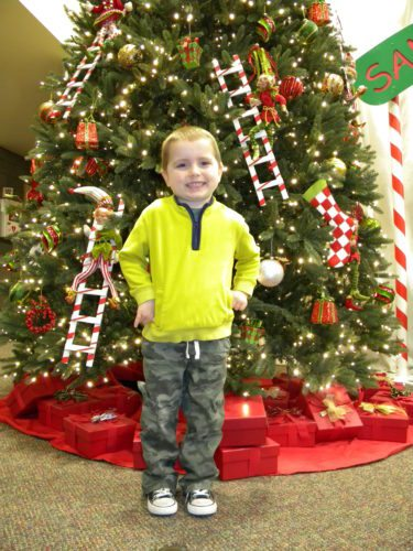 Zander Shirmeyer, nearly 4, gets the honor of turning on the holiday light display Wednesday night at the Fort Wayne Community Center on Main Street during the annual Night of Lights event. (By Kevin Kilbane of News-Sentinel.com)