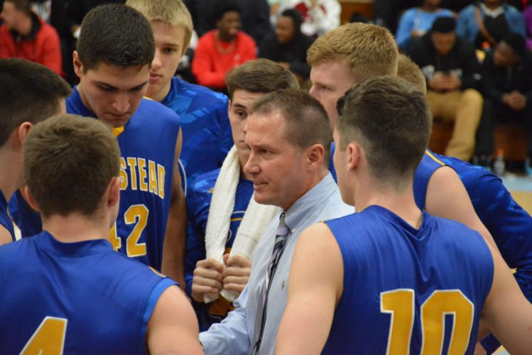 Homestead boys basketball coach  Chris Johnson directs his team in a  huddle during the championship game  of the SAC Holiday Tournament on  December 29, 2016 at Wayne High  School. (Photo by Dan Vance of The  News-Sentinel)