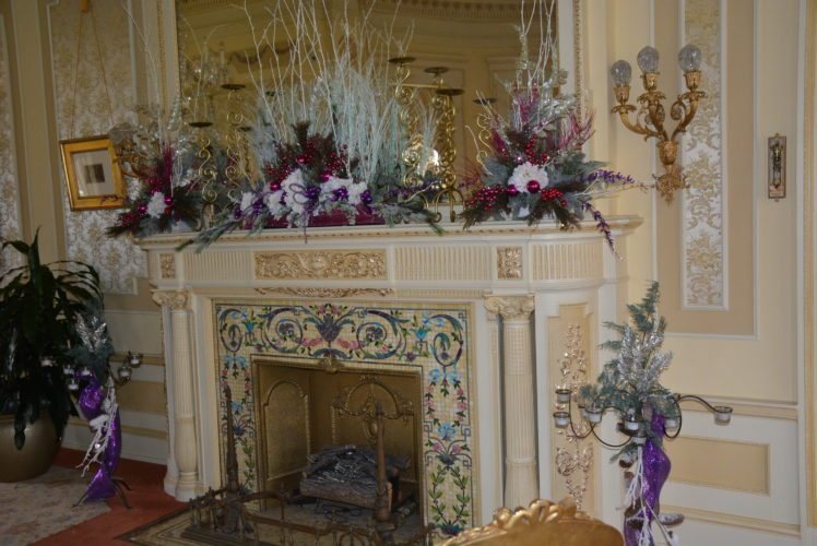 Ribbons and floral designs pull the colors from the fireplace front in the parlor at Brookside Mansion on the University of Saint Francis main campus, 2701 Spring St. (Photo by Lisa M. Esquivel Long of News-Sentinel.com)