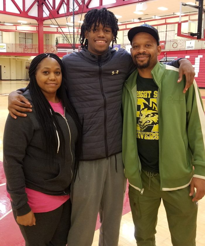 Keion Brooks Jr., center, poses with his parents Sarita and Keion Sr., after a practice at North Side High School. (Photo by Reggie Hayes of News-Sentinel.com)