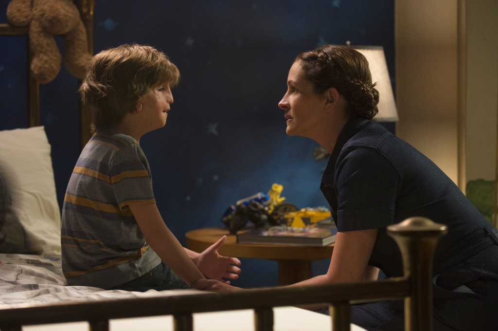 """Jacob Tremblay, left, who plays fifth-grader Auggie, and Julia Roberts, who plays his mom, star in the film """"Wonder,"""" which a few Fort Wayne families are praising for creating more awareness about children with cranio-facial syndromes. (Courtesy of Dale Robinette/Lionsgate via AP)"""