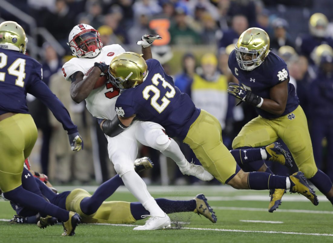 North Carolina State's Kelvin Harmon (3) is tackled by Notre Dame's Drue Tranquill (23) during the second half of an NCAA college football game, Saturday, Oct. 28, 2017, in South Bend, Ind. Notre Dame won 35-14. (AP Photo/Darron Cummings)