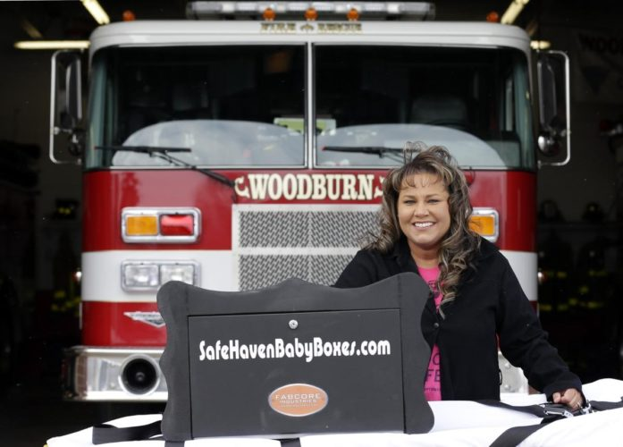 "Monica Kelsey helped install Indiana's first ""baby box"" at the Woodburn fire station last year, and the second box in Michigan City just saved a life. (AP photo)"
