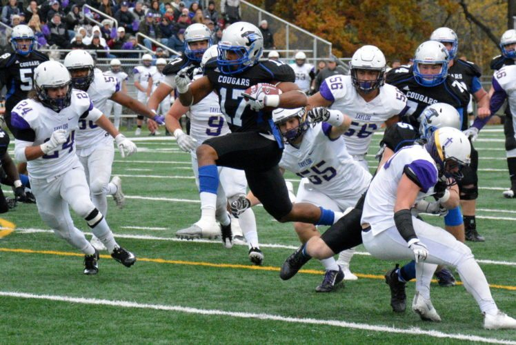 Saint Francis running back Justin Green, center, sprints for a touchdown against Taylor in the last regular-season game. (Photo by Reggie Hayes of News-Sentinel.com)