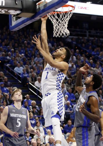 Kentucky's Sacha Killeya-Jones (1) shoots between Fort Wayne's Jax Levitch (5) and Xzavier Taylor during the first half of a game Wednesday in Lexington, Ky. (By The Associated Press)