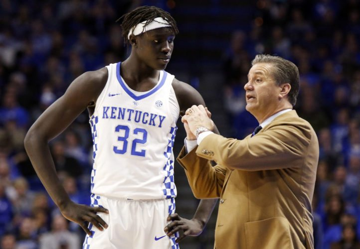 Kentucky's Wenyen Gabriel, left, receives instructions from Wildcats' men's basketball coach John Calipari during the second half of a game against Fort Wayne Wednesday in Lexington, Ky. (By The Associated Press)