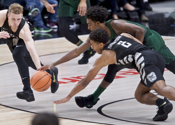 Butler guard Paul Jorgensen, left, guard Aaron Thompson, right and Portland State guard Deontae North dive for a loose ball during the first half of a game in the Phil Knight Invitational tournament in Portland, Ore. Friday. (By The Associated Press)