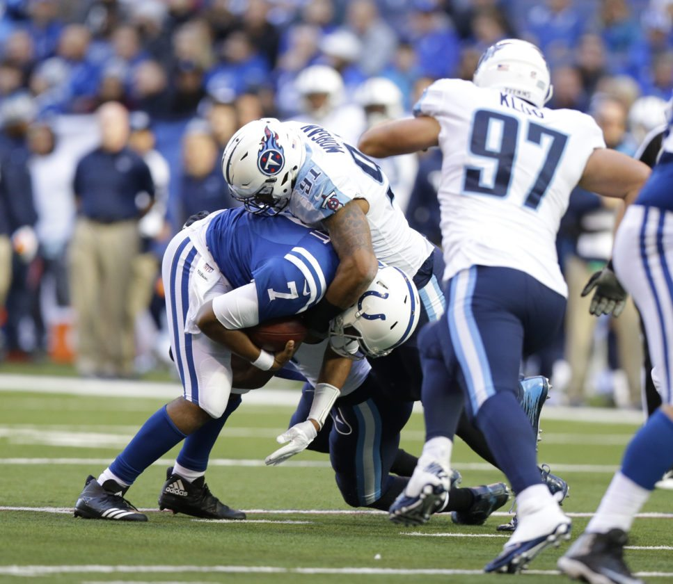 Indianapolis Colts quarterback Jacoby Brissett (7) is sacked by Derrick Morgan (91) during the first half of an NFL football game, Sunday, Nov. 26, 2017, in Indianapolis. (AP Photo/Michael Conroy)
