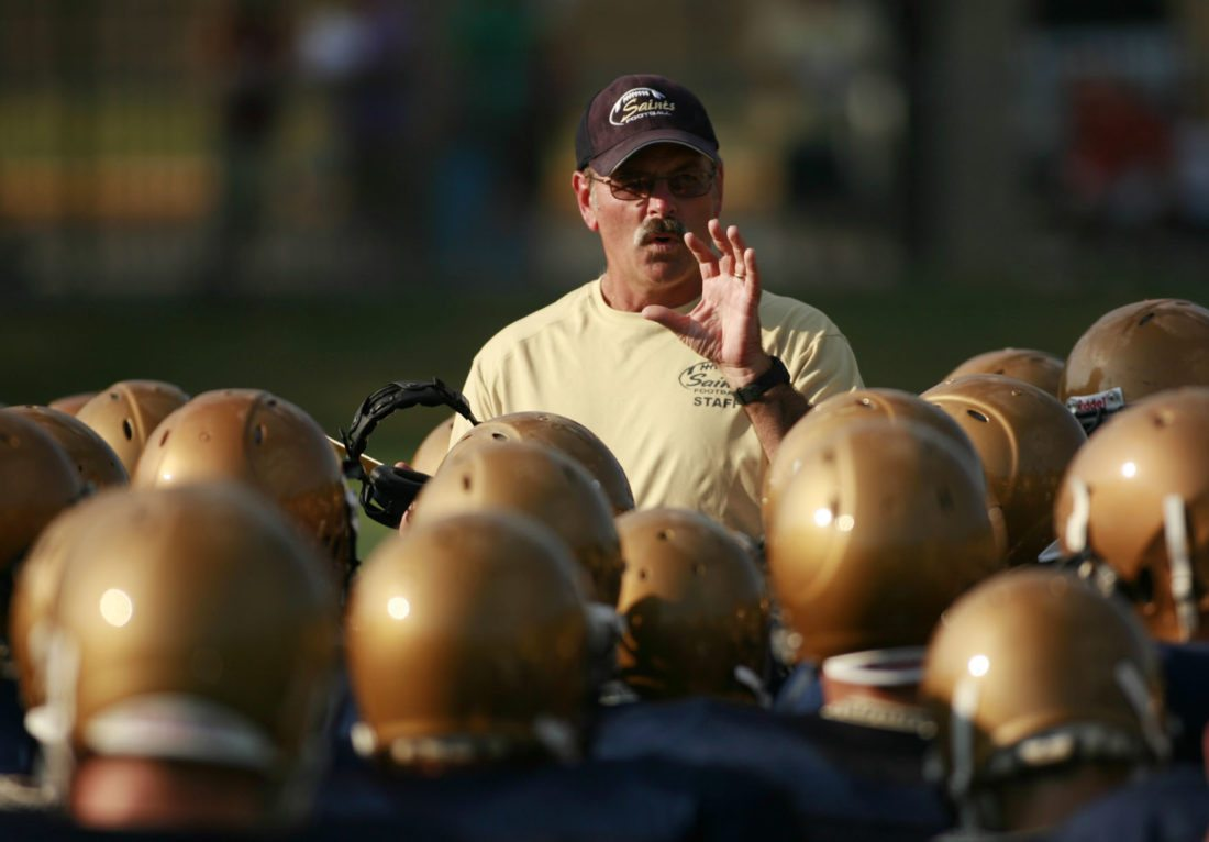 Bishop Dwenger football coach Chris Svarczkopf talks to his players during a break in a 2009 scrimmage. Svarczkopf  announced his retirement to the team in a meeting today.
