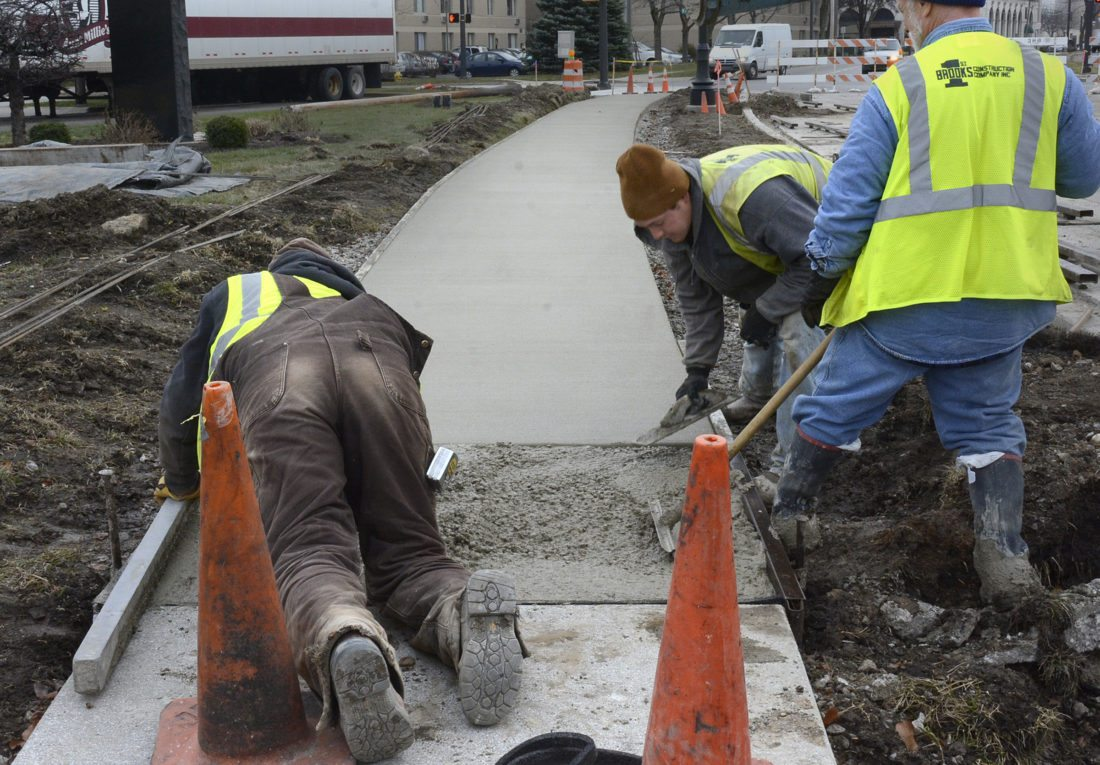 Scenes like this will be increasingly common as the city begins sidewalk projects funded through a recent income-tax increase. (News-Sentinel file photo)