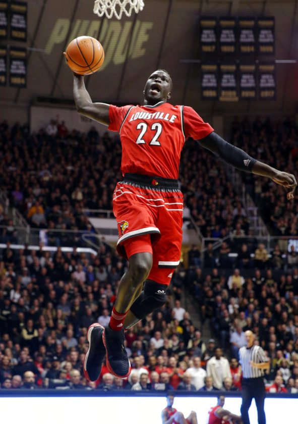 Louisville forward Deng Adel (22) goes up for a dunk against Purdue in the first half of an NCAA college basketball game in West Lafayette, Ind., Tuesday, Nov. 28, 2017. (AP Photo/Michael Conroy)