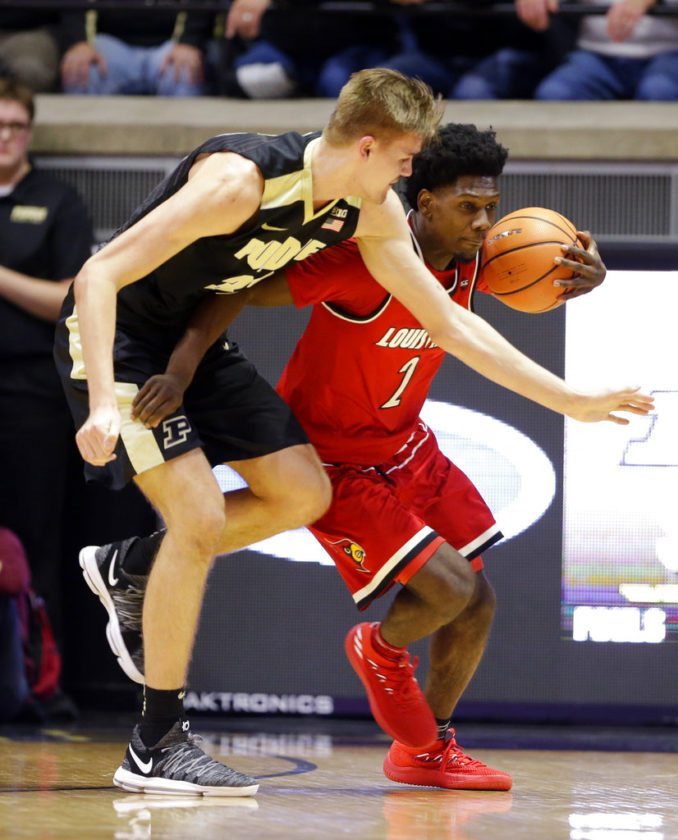 Louisville guard Darius Perry (2) holds off Purdue forward Matt Haarms (32) as they go for a loose ball in the first half of an NCAA college basketball game in West Lafayette, Ind., Tuesday, Nov. 28, 2017. (AP Photo/Michael Conroy)