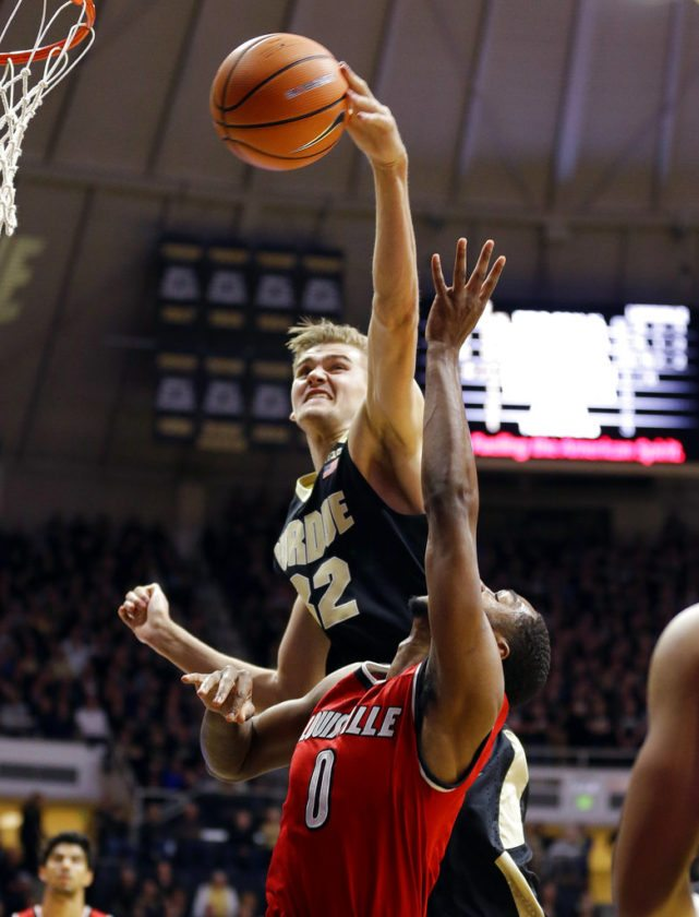 Purdue forward Matt Haarms (32) jumps from behind to block the shot of Louisville forward V.J. King (0) in the first half of an NCAA college basketball game in West Lafayette, Ind., Tuesday, Nov. 28, 2017. (AP Photo/Michael Conroy)
