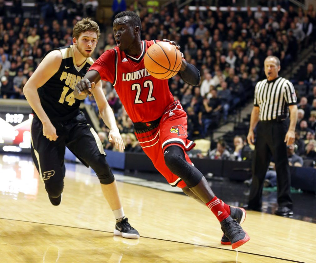 Louisville forward Deng Adel (22) drives on Purdue guard Ryan Cline (14) in the first half of an NCAA college basketball game in West Lafayette, Ind., Tuesday, Nov. 28, 2017. (AP Photo/Michael Conroy)