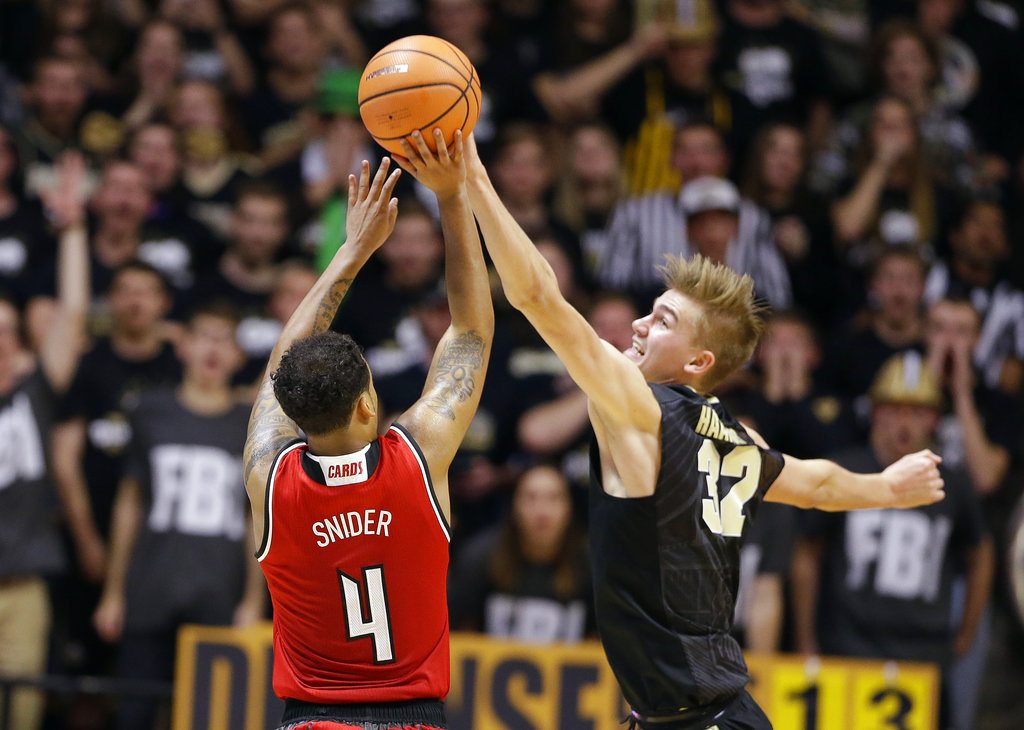 Purdue forward Matt Haarms (32) blocks the shot of Louisville guard Quentin Snider (4) late in the second half of an NCAA college basketball game in West Lafayette, Ind., Tuesday, Nov. 28, 2017. Purdue defeated Louisville 66-57. (AP Photo/Michael Conroy)