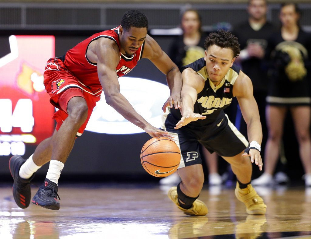 Louisville forward V.J. King (0) and Purdue guard Carsen Edwards (3) dive for a loose ball in the second half of an NCAA college basketball game in West Lafayette, Ind., Tuesday, Nov. 28, 2017. Purdue defeated Louisville 66-57. (AP Photo/Michael Conroy)