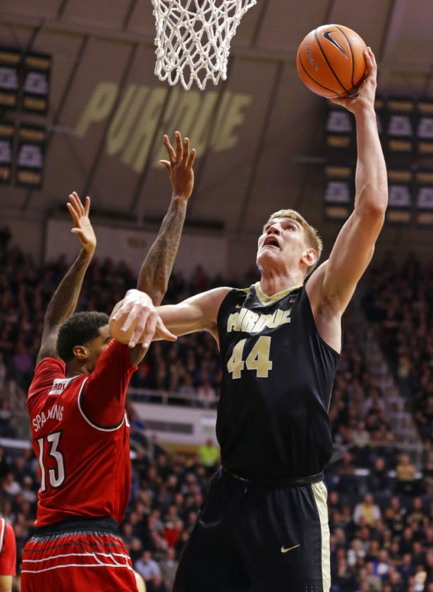 Purdue center Isaac Haas (44) shoots over Louisville forward Ray Spalding (13) in the second half of an NCAA college basketball game in West Lafayette, Ind., Tuesday, Nov. 28, 2017. Purdue defeated Louisville 66-57. (AP Photo/Michael Conroy)