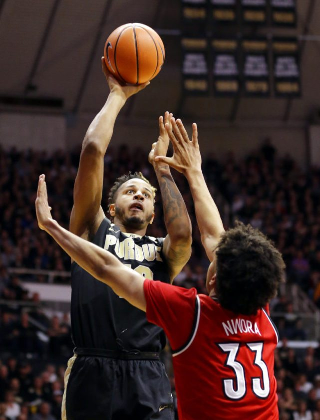 Purdue forward Vincent Edwards (12) shoots over Louisville forward Jordan Nwora (33) in the second half of an NCAA college basketball game in West Lafayette, Ind., Tuesday, Nov. 28, 2017. Purdue defeated Louisville 66-57. (AP Photo/Michael Conroy)
