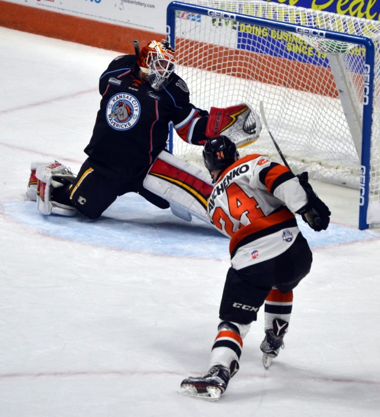"Komets center Dennis Kravchenko, shown here shooting against Kansas City's Tyler Parsons, was a child actor in the movie ""Stuck on You."" (By Blake Sebring of News-Sentinel.com)"