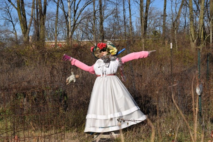This scarecrow in the Bluffton Road community garden wears her summer white Monday though temperatures were a bit chilly. (Photo by Lisa M. Esquivel Long of News-Sentinel.com)