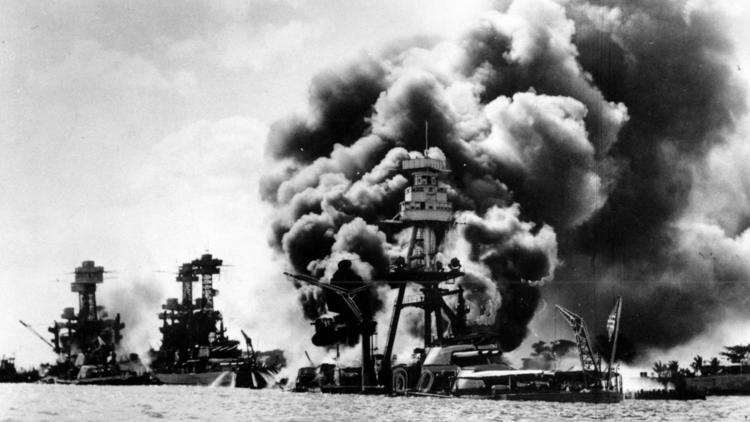 """Pearl Harbor's """"battleship row"""" following the Japanese Attack on Dec. 7, 1941. The destroyed U.S.S. Arizona is in the foreground. (AP photo)"""