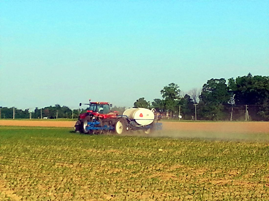 A farmer works in a field between Bluffton and Ossian in 2014. The Northeast Indiana Regional Partnership wants to know what residents of rural communities see as the highlights of living there. (News-Sentinel.com file photo)