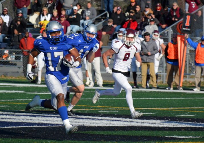 Saint Francis running back Justin Green accelerates during a fourth-quarter, 61-yard touchdown run that put the Cougars ahead for good in their 43-36 win over Morningside in the NAIA semifinals Saturday at Bishop D'Arcy Stadium. (Photo by Reggie Hayes of News-Sentinel.com)