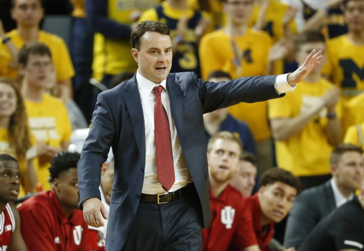 Indiana University men's basketball coach Archie Miller signals against Michigan in the first half of a game in Ann Arbor, Mich. (By The Associated Press)
