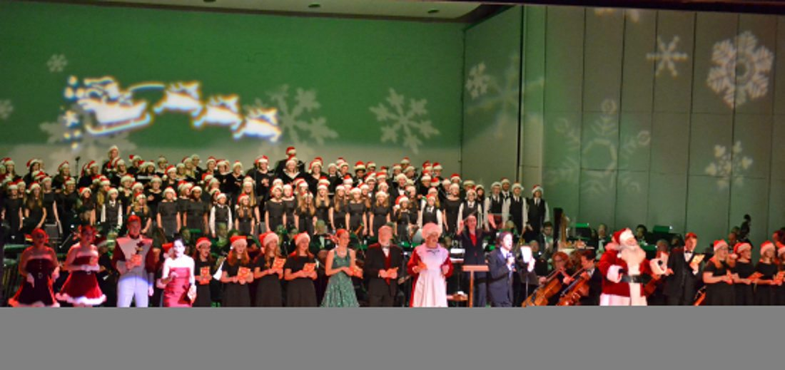 The Fort Wayne Philharmonic, the Philharmonic Chorus, the Fort Wayne Children's Choir and Youth Chorale and the cast of the Holiday Pops lead a singalong with the audience at the Embassy Theatre on in 2016. The Holiday Pops event is getting a makeover for this year (News-Sentinel.com file photo)