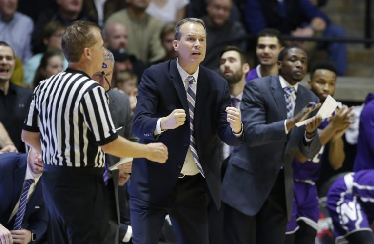 Northwestern men's basketball coach Chris Collins shouts to his team in the second half of a game against Purdue in West Lafayette Sunday. (By The Associated Press)