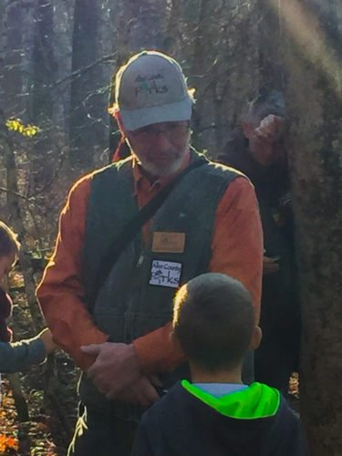 "Fox Island County Park part-time naturalist Jeff Ormiston answers a young hiker's question about beavers during Sunday afternoon's ""Hike and Hot Chocolate"" program at the park. (Photo by Lisa M. Esquivel Long of The News-Sentinel)"