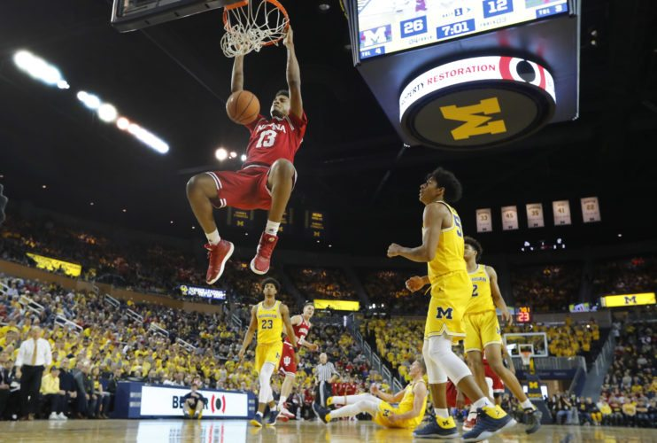Indiana forward Juwan Morgan (13) dunks against Michigan in the first half of a game in Ann Arbor, Mich. Saturday. (By The Associated Press)