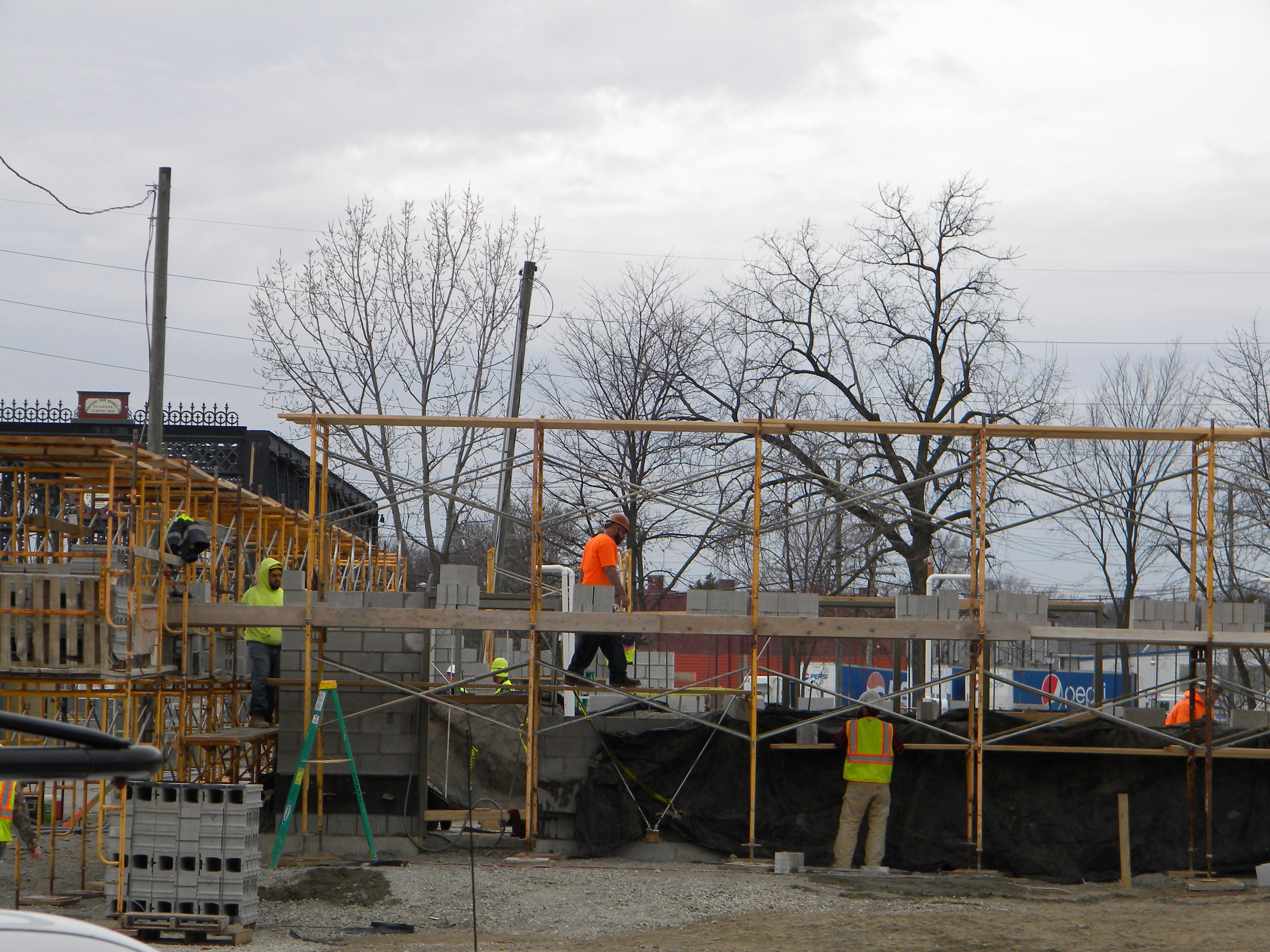 Walls rising on pavilion in Promenade Park as riverfront