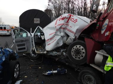 A 2007 Freightliner semi-tractor pulling a flatbed trailer rear-ended a van, causing a chain-reaction crash Monday morning on U.S. 30, according to the Indiana State Police.  (Photo courtesy of the Indiana State Police)