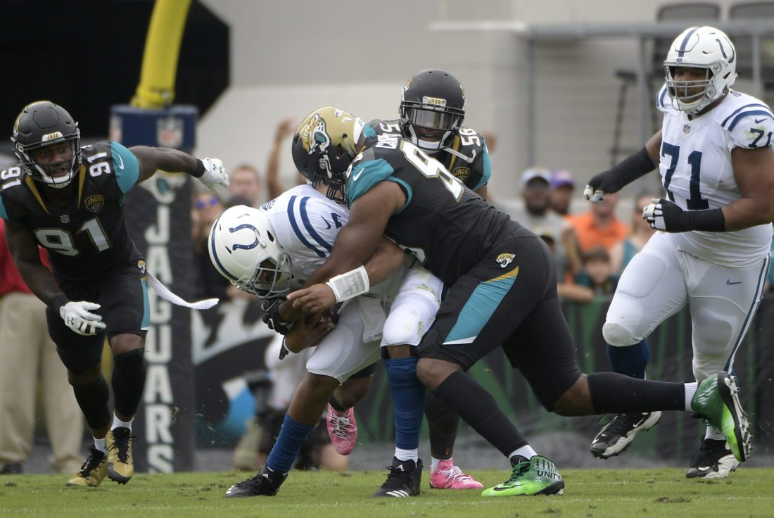 Jacksonville Jaguars defensive end Calais Campbell sacks Indianapolis Colts quarterback Jacoby Brissett on Sunday in Jacksonville, Fla. (Photo by the Associated Press)