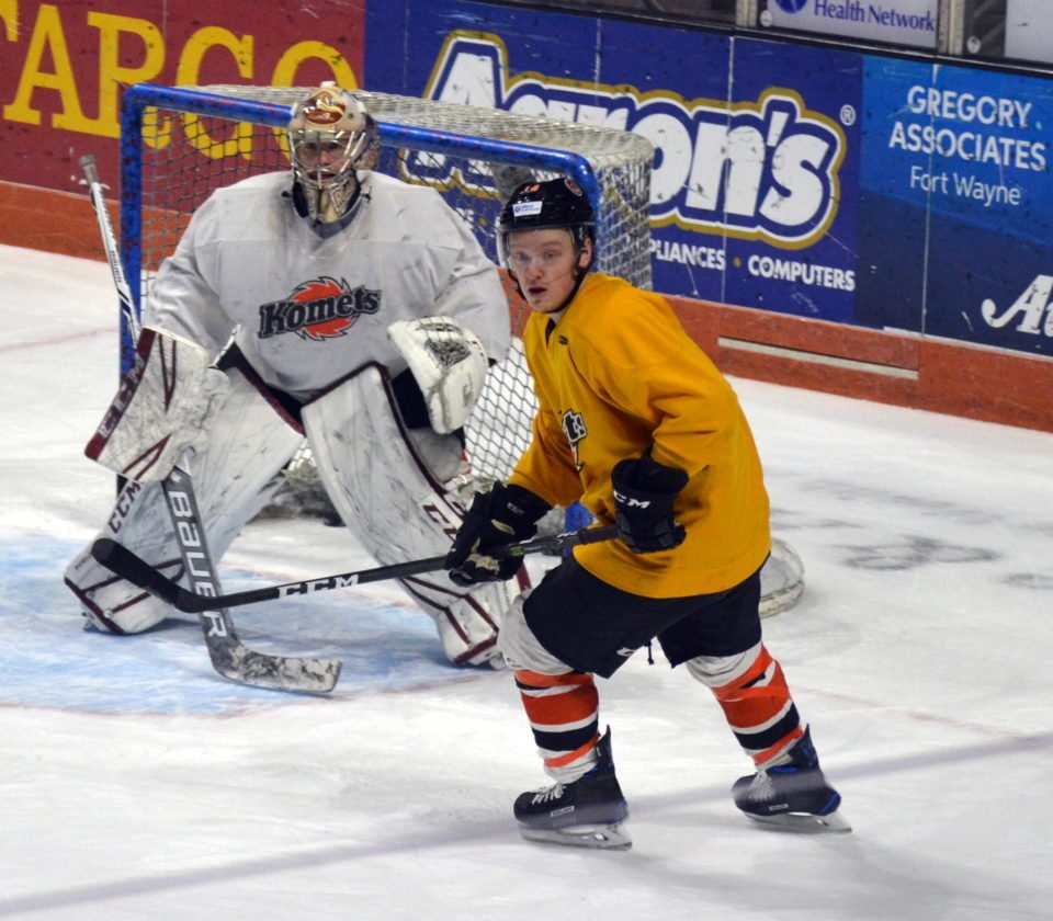 Forward Artur Tyanulin cuts in front of Komets goaltender Michael Houser during today's practice. (By Blake Sebring of News-Sentinel.com)