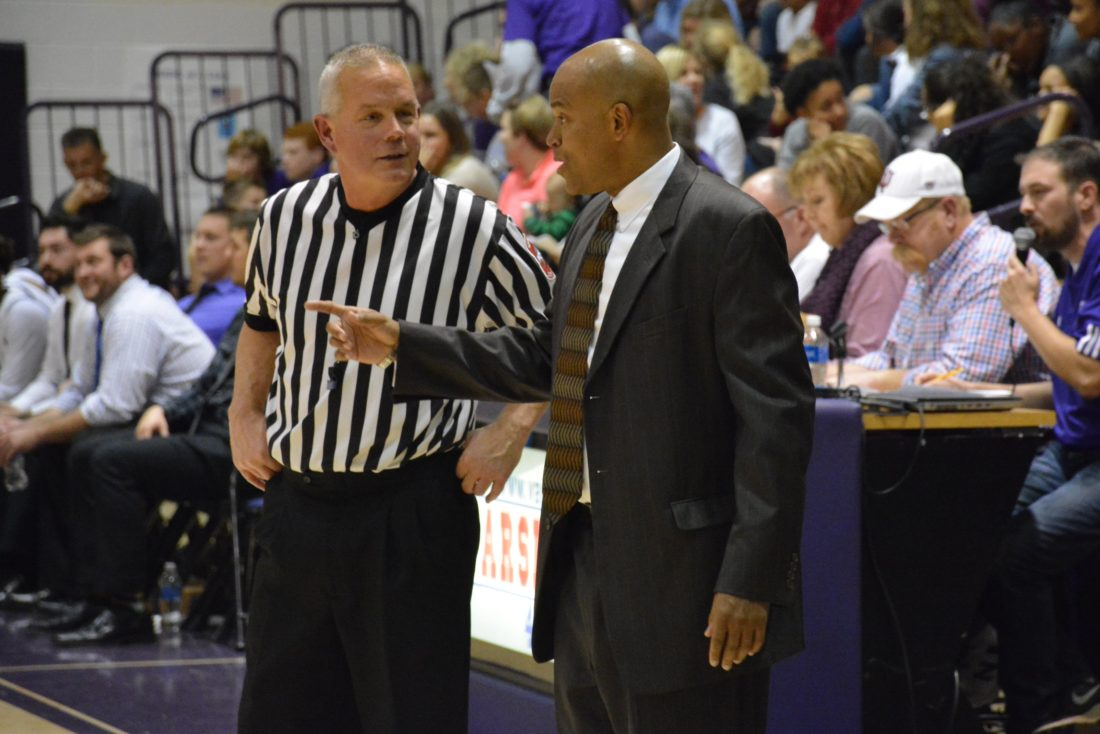 South Side boys basketball coach J.J. Foster has a discussion with an official during a November 25 game. (Photo by Dan Vance of  The News-Sentinel)
