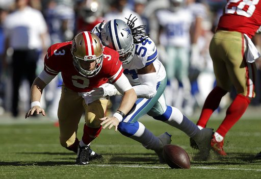 San Francisco 49ers quarterback C.J. Beathard (3) fumbles the ball as he is hit by Dallas Cowboys outside linebacker Jaylon Smith (54) during a game on Oct. 22, 2017. The Cowboys recovered the fumble. (Photo by the Associated Press)