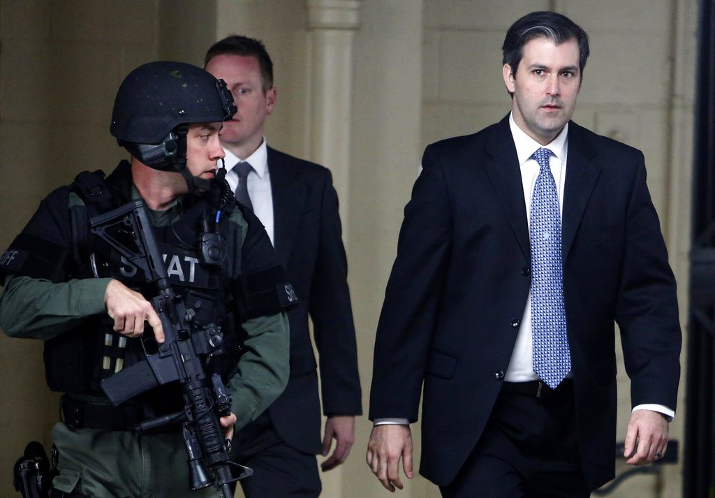 FILE - In this Monday, Dec. 5, 2016, file photo, former South Carolina officer, Michael Slager, right, walks from the Charleston County Courthouse under the protection of the Charleston County Sheriff's Department after a mistrial was declared for his trial in Charleston, S.C. Slager, who fatally shot a black motorist, Walter Scott, in 2015, could learn his fate as soon as his federal sentencing hearing winds down. On Thursday, Dec. 7, 2017, attorneys are expected to call friends and relatives of both men who'll tell the judge how Scott's death and the officer's arrest have impacted their lives. (AP Photo/Mic Smith, File)