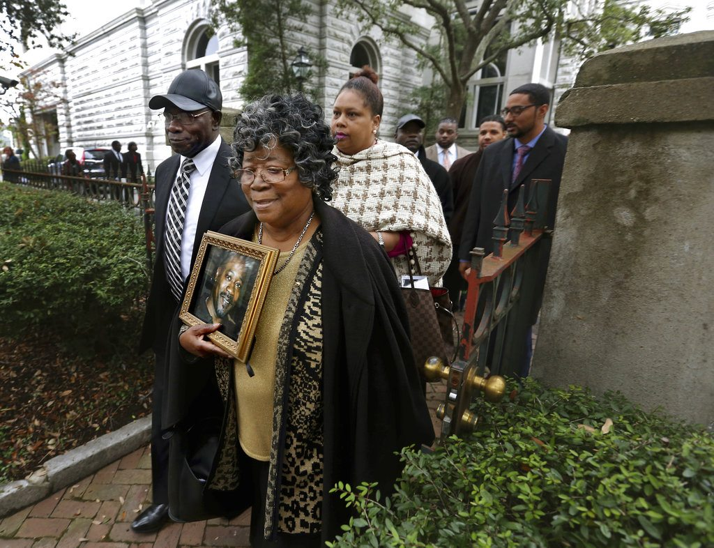 The parents of Walter Scott, Walter Scott Sr. and Judy Scott, leave the courthouse after former North Charleston police officer Michael Slager was sentenced to 20 years in prison for the 2015 shooting death of their son, Thursday, Dec. 7, 2017, in Charleston, S.C. (Grace Beahm Alford/The Post And Courier via AP)