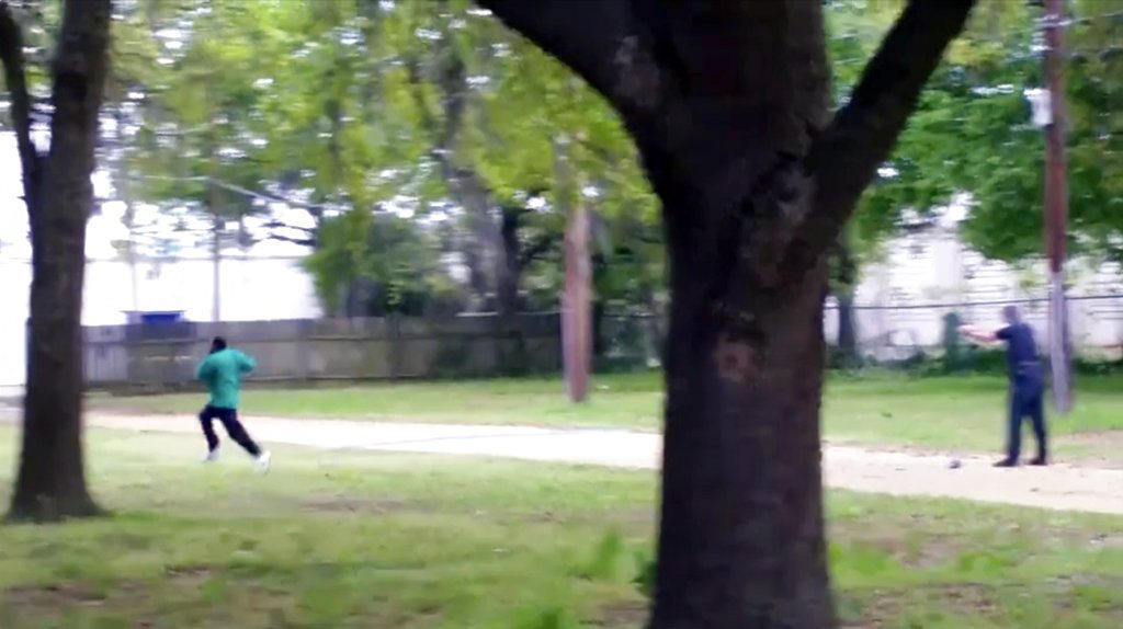 FILE - In this April 4, 2015 image from video, Walter Scott, left, is shot by police officer Michael Thomas Slager in Charleston, S.C. Slager, a white former South Carolina officer was sentenced to 20 years in prison on Thursday, Dec. 7, 2017,  for fatally shooting Scott, an unarmed black motorist in the back in 2015, wrapping up a case that became a rallying cry for the Black Lives Matter movement.  (Feidin Santana via AP, File)