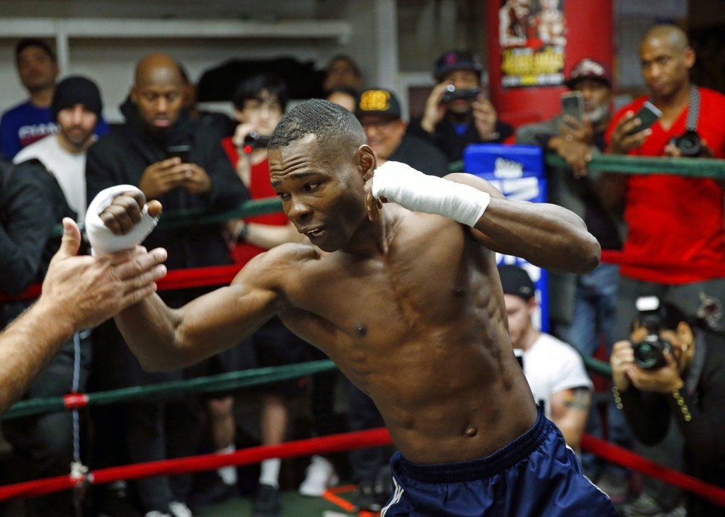 Boxer Guillermo Rigondeaux, works out with his trainer at a Manhattan gym in preparation for his WBO super featherweight title fight against title holder Vasyl Lomachenko, Wednesday, Dec. 6, 2017, in New York. Rigondeaux, 37, is a Cuban defector who resides in Miami. Boxing aficionados say the fight, slated for Saturday evening in New York, pits two of boxing's pound-for-pound best fighters. (AP Photo/Kathy Willens)