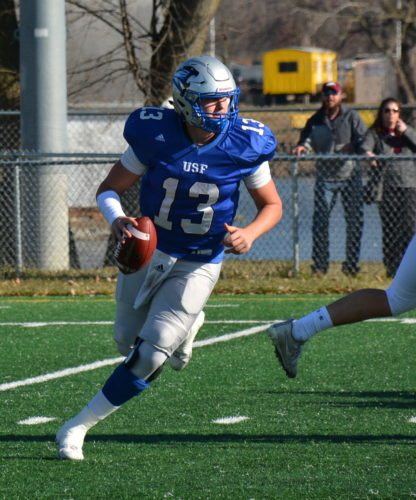 Saint Francis quarterback Nick Ferrer rolls out, looking for a receiver, during the team's NAIA semifinal win over Morningside on Dec. 2 at Bishop D'Arcy Stadium. (Photo by Reggie Hayes of news-sentinel.com)