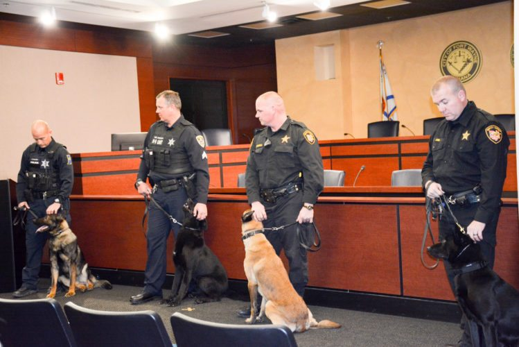 From left, Fort Wayne Police Officer Scott Wilson with Blaze, New Haven Police Sgt. Brent Bolinger and Cato, and Williams County (Ohio) Sheriff's Department Deputy Jason Randall and Django and Deputy Ken Jacobs with Ruin graduated from the fall basic K9 class Friday. (Photo by Lisa M. Esquivel Long of News-Sentinel.com)