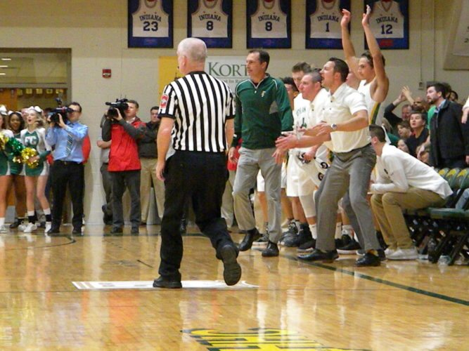 The Floyd Central bench erupts following a play in the opening half of the Highlanders' game with New Albany Friday in Floyds Knobs. (By Tom Davis of News-Sentinel.com)
