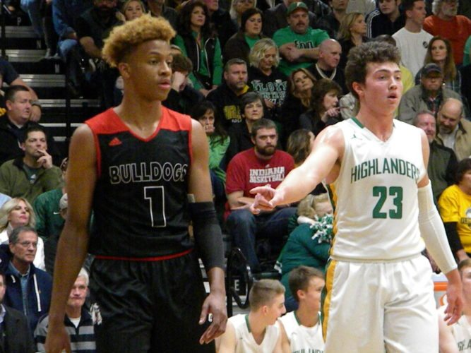 Floyd Central forward Luke Gohman keeps a close eye defensively on New Albany star Romeo Langford Friday in Floyds Knobs. (By Tom Davis of News-Sentinel.com)