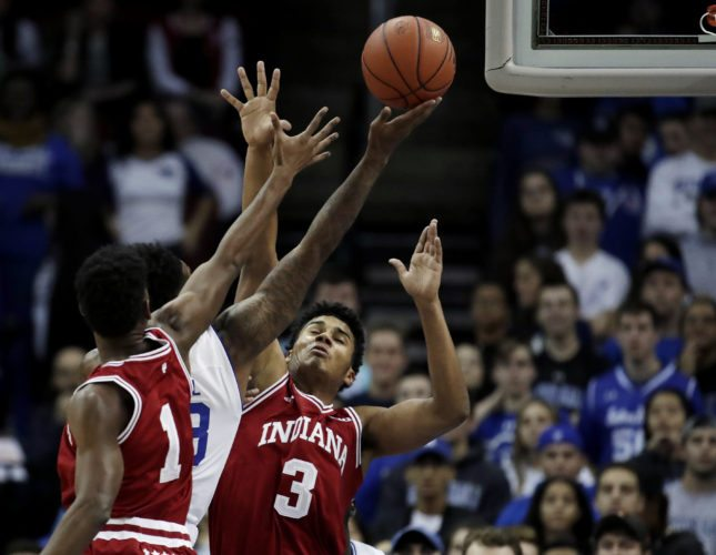 Seton Hall guard Myles Powell, center, goes up for a shot against Indiana guard Aljami Durham, left,  and forward Justin Smith, right, during the first half of a game last month in Newark, N.J. (By The Associated Press)