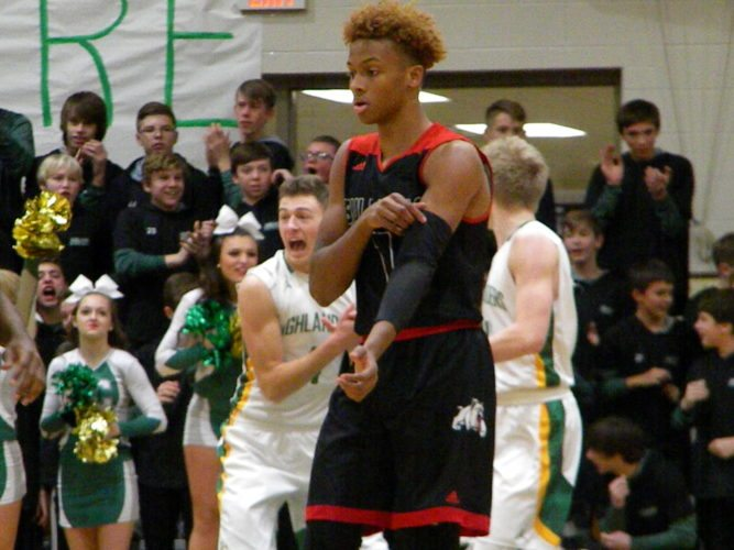 New Albany High School basketball star Romeo Langford adjusts his arm band during a game Friday at Floyd Central High School in Floyds Knobs. (By Tom Davis of News-Sentinel.com)