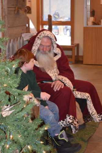 Father Christmas, also known as Michael  Gobert, manager of Deer Run Wilderness Area, visits with a young guest at  Saturday's Nature's Christmas at  Metea County Park, 8401 Union Chapel Road.  (Photo by Lisa M. Esquivel Long of News-Sentinel.com)